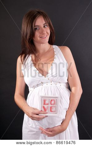 Pretty Pregnant Woman With Tablet