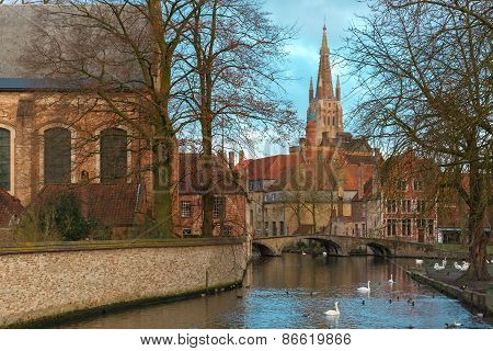 Landscape at Lake Minnewater and church in Bruges, Belgium