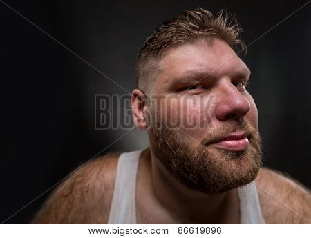 Hipster man with beard over dark background. Wide angle view