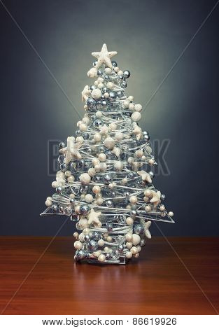 Decorative christmas tree on wooden table