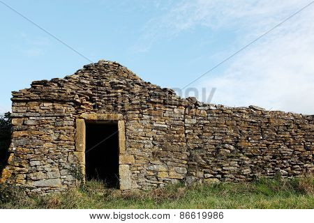 old and typical stone hut in the vineyards of Beaujolais
