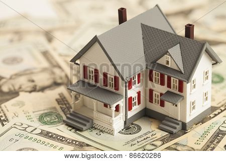 Single Family House On Pile Of Money