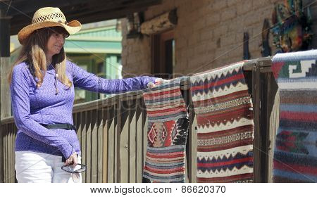 A Beautiful Cowgirl Shops For Indian Blankets