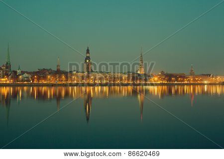 Night view of Riga centre with reflection in river