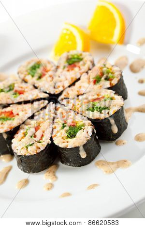 Maki Sushi - Roll with Chuka Seaweed, Sweet Pepper and Salad Leaf inside. Nori outside. Served with Nuts Sauce