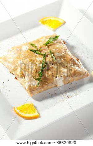 Stuffed Omelet with Orange Slice and Green Herbs