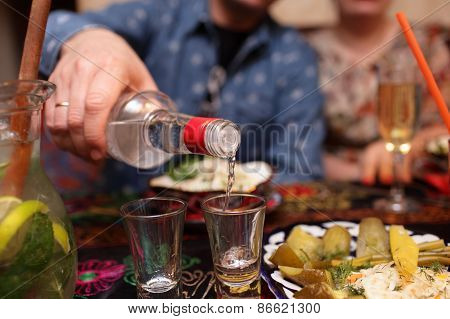 Man Pouring Vodka
