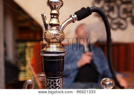 Person Smoking Nargile