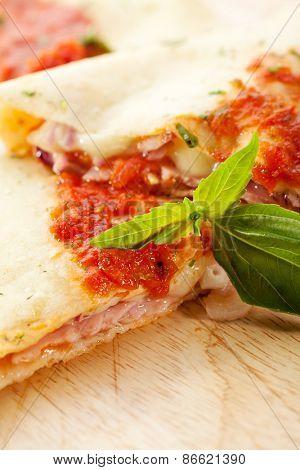Calzone - Stuffed Pizza with Tomato, Mozzarella and Ham