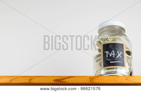 Single Glass Jar On Wooden Shelf For Saving Money