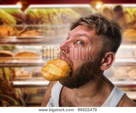 Man eating bread in the bakery shop