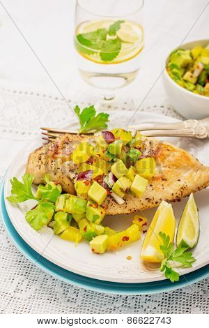 Grilled chicken breast with fresh mango salsa,
