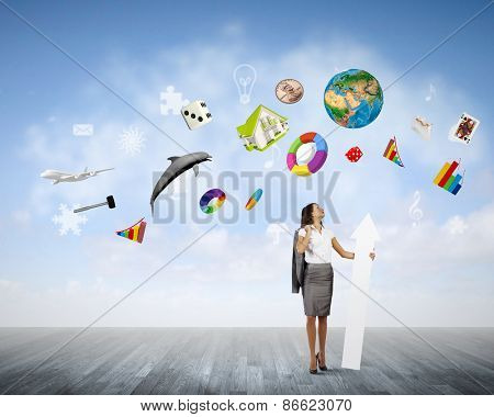 Young businesswoman in suit with increasing arrow in hand. Elements of this image are furnished by NASA