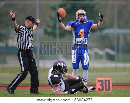 GRAZ, AUSTRIA - APRIL 04, 2014: WR Philipp Sommer (#4 Giants) catches the ball in an AFL football game.