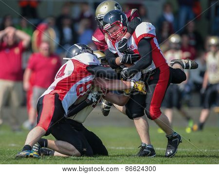 WINDEN, AUSTRIA - APRIL 12, 2014: RB Thomas Weis (#23 Spartans) is tackled by DB Christopher Moritz (#24 Legionaries).