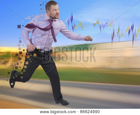Running businessman in a hurry on blurred background