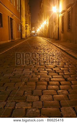 Cobbled street in the old city at night
