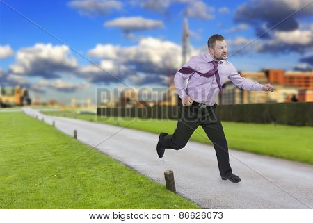 Running businessman in a hurry with modern city in background