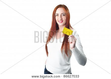 Close-up Portrait Of Young Smiling Redhead Woman Holding Gold Credit Card