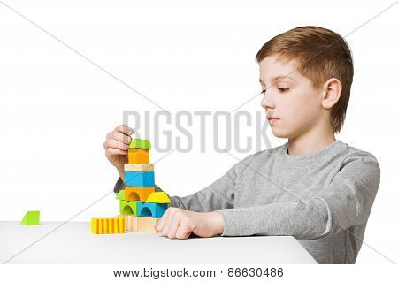 Boy Building House Made Of Wooden Blocks