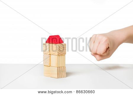 Human Hand About To Destroyi House Made Of Wooden Blocks