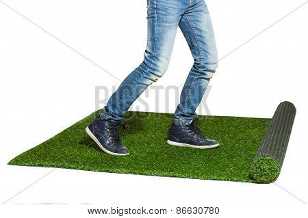 Child Legs Stepping On Artificial Grass Isolated On White ?????