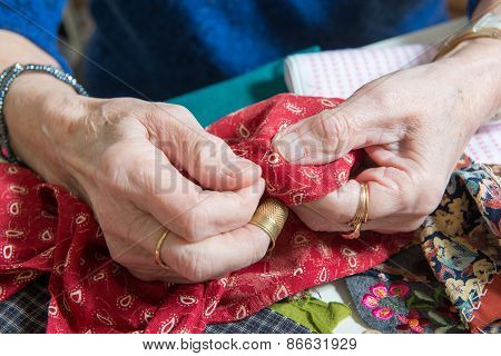 Close-up Of The Hands Of A Seamstress