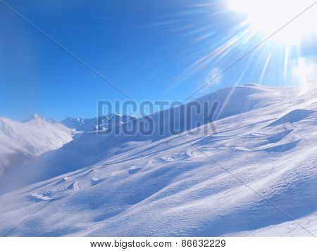 Ski Snow Slope And Blue Sky With Sun