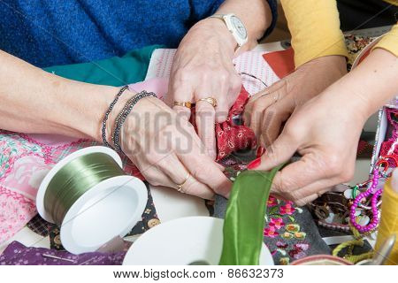 Close-up Of The Hands Of  Seamstress