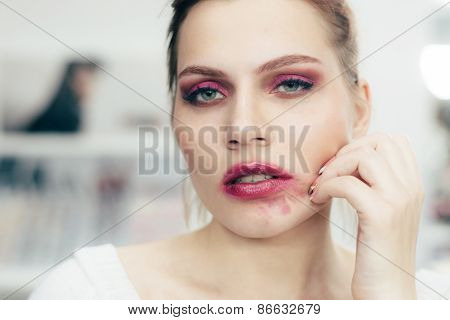 The Girl With The Smeared Lipstick