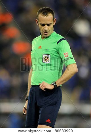 BARCELONA - 8, FEB: Referee Mario Melero Lopez check the time during a Spanish League match between RCD Espanyol vs Valencia CF at the Estadi Cornella on February 8, 2015 in Barcelona, Spain