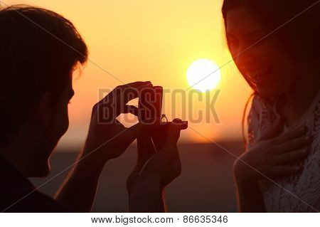 Back Light Of A Proposal Of Marriage At Sunset