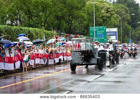 SINGAPORE MARCH 29: Mourners bid last farewell as gun carriage bearing the coffin of ex prime minister of Singapore, Mr Lee Kuan Yew drove pass for state funeral service Mar 29 Singapore 2015