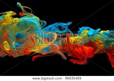 Colorful ink swirling through water