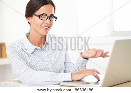 Happy Female Employee Using The Computer