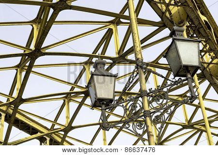 Decorative lamps hanging from old bridge
