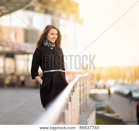 Young business woman standing in the big city
