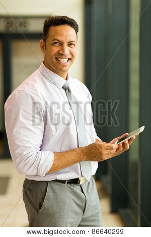 good looking mid age business man holding smart phone
