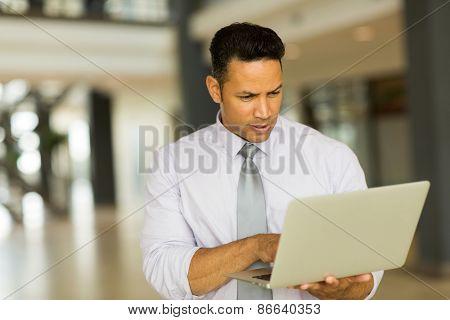 successful entrepreneur working on laptop computer