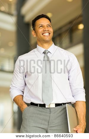 happy business man standing in modern office