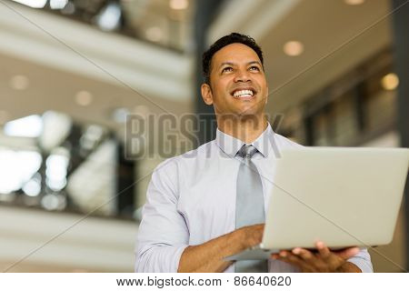 handsome businessman with laptop computer