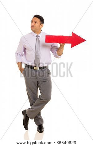 thoughtful middle aged man with red direction arrow on white background