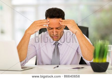 overworked businessman sitting in office