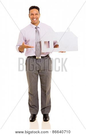 happy middle aged man presenting white paper house on white background