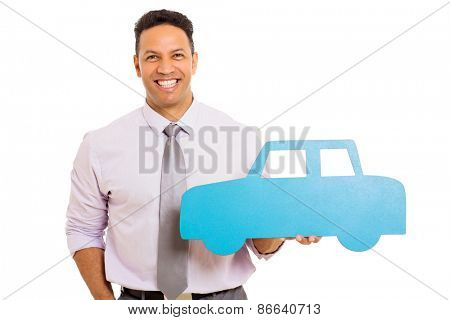 good looking businessman showing blue paper car on white background