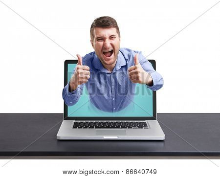 happy man got out of the laptop and showing thumbs up against white background