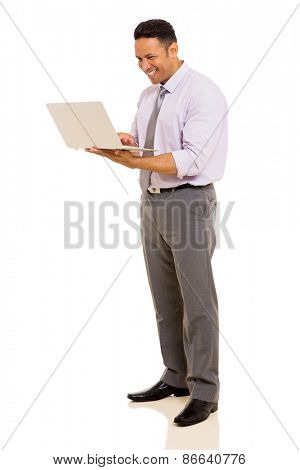 happy middle aged man using laptop on white background