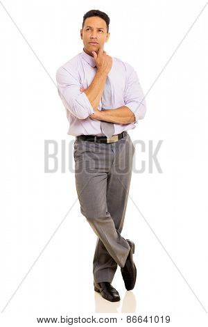 thoughtful mid age businessman standing on white background