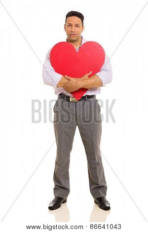 middle aged man hugging red heart shape isolated on white background