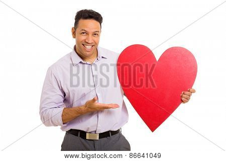 cheerful mid age man presenting red heart shape on white background